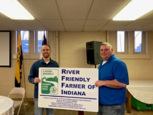 L) Vice Chair Jarrod Kunkel presents the award to Kevin Cassiday - 2020 Wells County River Friendly Farmer!